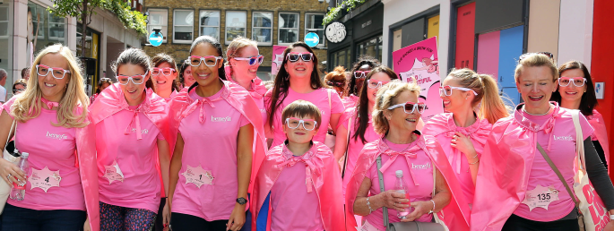 People walking the streets of London wearing pink for Benefit's 'Bold is Beautiful' march
