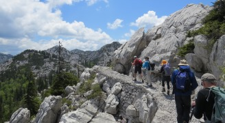 A group of people trekking up a rocky incline.