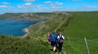 A group of people walking along the Jurassic coastline