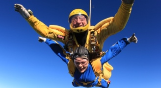 A man and a young woman skydiving